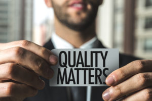 property management holding a quality matters sign